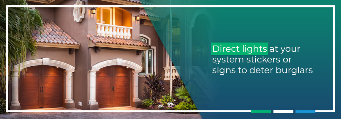 Direct lights at your system stickers or signs to deter burglars