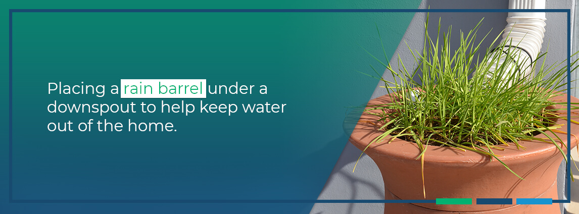placing a rain barrel under a downspout to help keep water out of the home